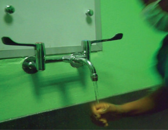 Figure 1 :Scrub sink with hand operated tap